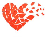 Broken heart breakup concept separation and divorce icon. Red cr. Umpled paper shaped as a torn love Royalty Free Stock Images