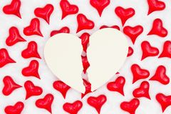 Broken heart card with red hearts on white fabric background. With copy space for your message royalty free stock image