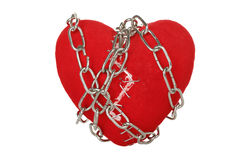 Broken heart. Chain wrapped around broken heart with staples isolated stock image