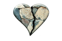 Cracked stone heart. Broken heart concept. Stone texture shaped in a form of heart with a crack in the middle Stock Image