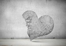 Broken heart. Conceptual image with big stone crashed heart Royalty Free Stock Images