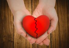 Broken heart in cupped hands Royalty Free Stock Photography