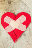 Broken heart on dirty background royalty free stock images