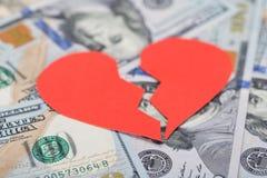 Broken heart on dollar bills Royalty Free Stock Photo