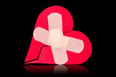 Broken heart fixed with adhesive bandage Stock Photography