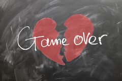 Broken heart with game over text