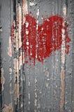 Broken Heart Graffiti. Spray painted heart graffiti over paint chipped wall Stock Image