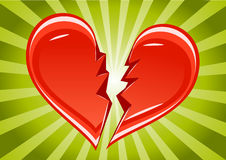 Broken heart. On green background Stock Photos