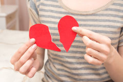 Broken heart in hands Stock Photo