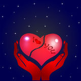 Broken heart and hands. Of the stars of the night Royalty Free Stock Images