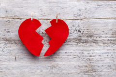 Broken heart. Hanging on rope stock photography
