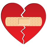 Broken heart with plaster royalty free stock photography