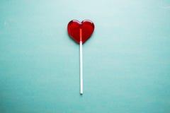 Broken heart lollipop stock image