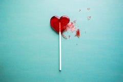 Broken heart lollipop royalty free stock image