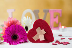 Broken Heart with love and flowers Stock Photography