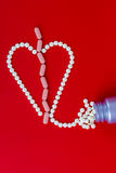 Broken heart made with pills Royalty Free Stock Image