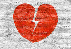Broken heart painted on brick wall Royalty Free Stock Image