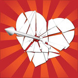Broken heart pierced by an arrow Royalty Free Stock Image