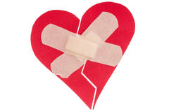 Broken heart with plaster Stock Photo