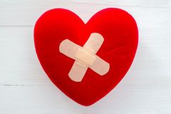 Broken heart with plaster Royalty Free Stock Image
