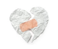 Broken heart. Plaster and paper broken heart on white background Royalty Free Stock Images