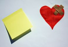 Broken heart with a post it note Stock Image