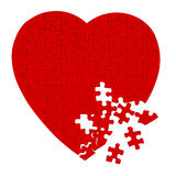 Broken heart puzzle isolated on white Royalty Free Stock Image