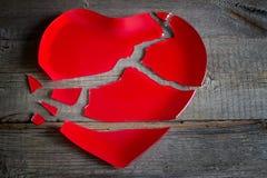 Broken heart red plate concept Stock Photos