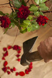Broken heart. Roses heart and ax in hand means, man whoes deside to brake relationship stock image
