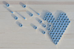 Broken heart of the screw nuts Royalty Free Stock Images