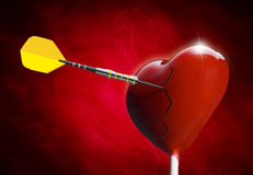 Broken Heart-shaped lollipop hit by an arrow Royalty Free Stock Image