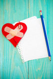 Broken heart with sheet of paper Royalty Free Stock Image