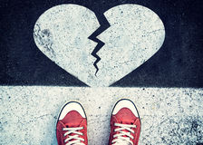 Broken heart sign on the road Stock Photos