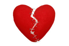 Broken heart. With staples isolated on white stock image