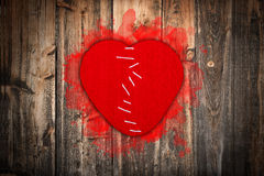 Broken heart stitched together Stock Photo