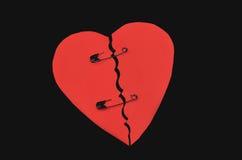 Broken heart. A broken heart tied with pins Stock Photo