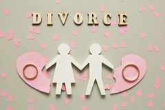 Broken heart and two gold rings. Civil family divorce, conflict royalty free stock image