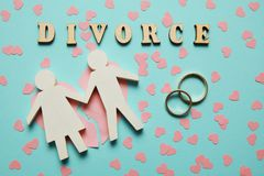 Broken heart and two gold rings. Civil family divorce, conflict stock photography