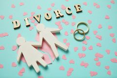 Broken heart and two gold rings. People couple divorce, love and conflict stock photo