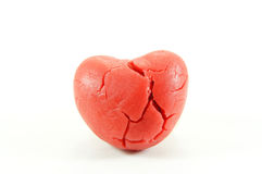Broken heart on white background. Red broken heart on white background Stock Photos