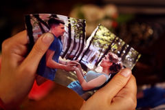 Broken heart woman. Couple break up. Woman and men quarrel. Close up of female hands tearing family pictures Stock Photography
