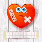 Broken heart on wooden background and copy space Stock Images