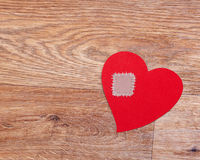 Broken heart on wooden floor with copy space Royalty Free Stock Images