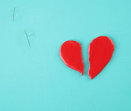 Broken heart on a wooden texture.  Royalty Free Stock Photos