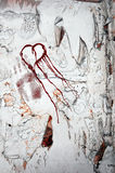 Broken hearted. Chipped concrete wall with symbolic blood drawn broken heart and hand print. Representation of lost soul mates and broken hearted Stock Photos