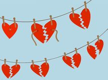 Broken Hearts hanging from clothing line from pegs Stock Photography