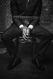Broken helpless man tied with chains Stock Photos