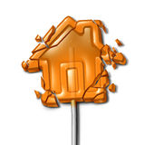 Broken Home. Concept as a shattered candy lollipop shaped as a troubled house as a family crisis symbol or financial foreclosure due to overdue mortgage loan Royalty Free Stock Photos