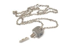 Broken house key on chain isolated on white background Royalty Free Stock Photography