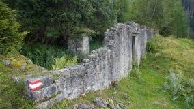 Broken house ruin on mountain stock photo
